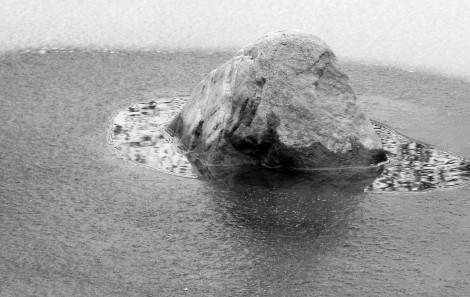 Rock in the frozen Lochan Uaine (Green Loch)