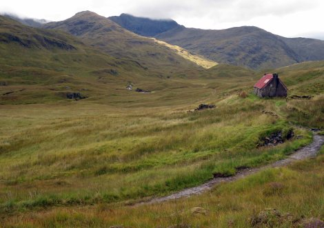 Camban Bothy as rain clouds touch the summit of the hills